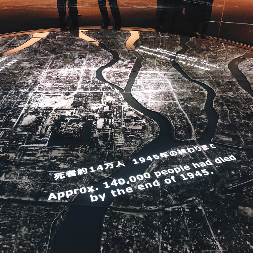 A moving projection of the blast radius over the city. The map has a before and after view, of which the latter one is a horrifying visualisation of the destruction caused by the bomb.