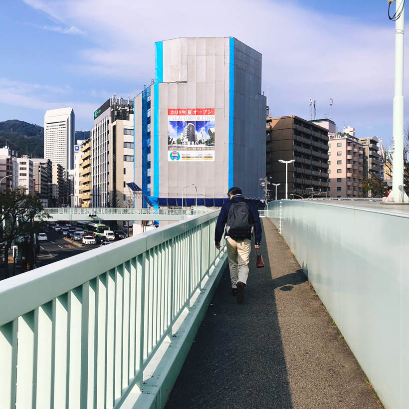 One of the many walking bridges over the busy streets in the center of Kobe.