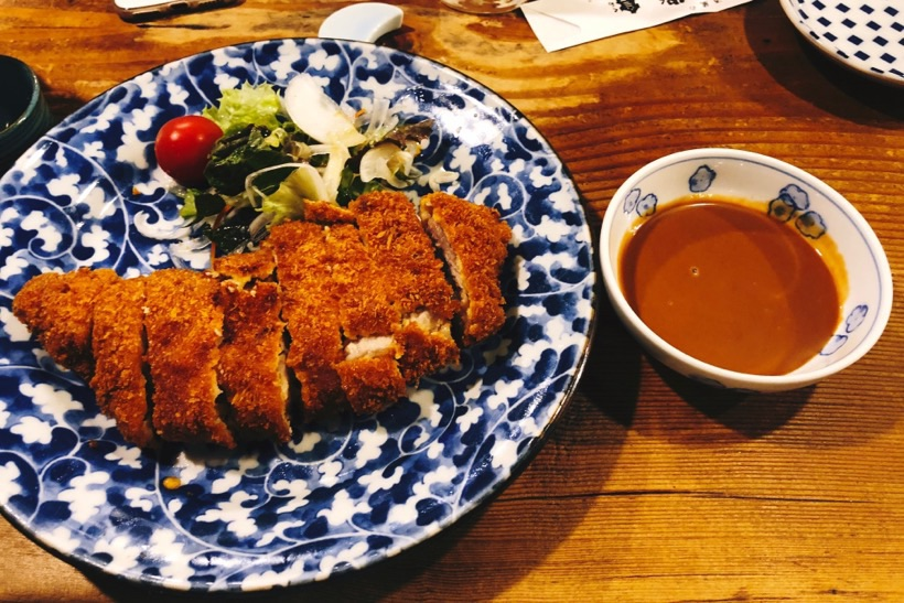 Tonkatsu - deep fried chicken covered with panko breadcrumbs - in a small izakaya in the center of Kyoto, Japan.