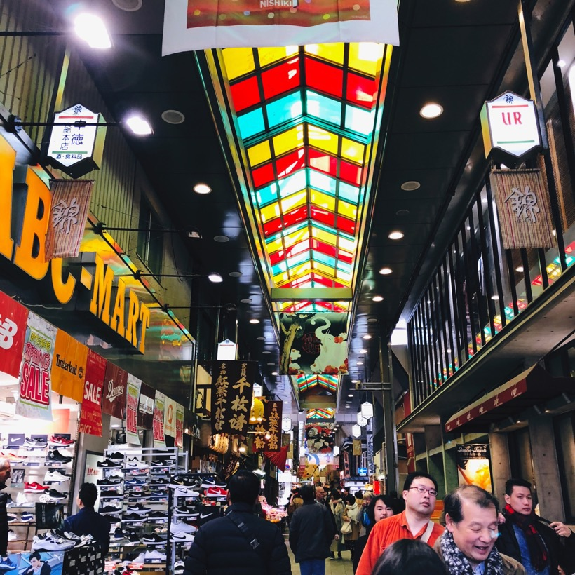 People walking in Nishiki Market in Kyoto, Japan.
