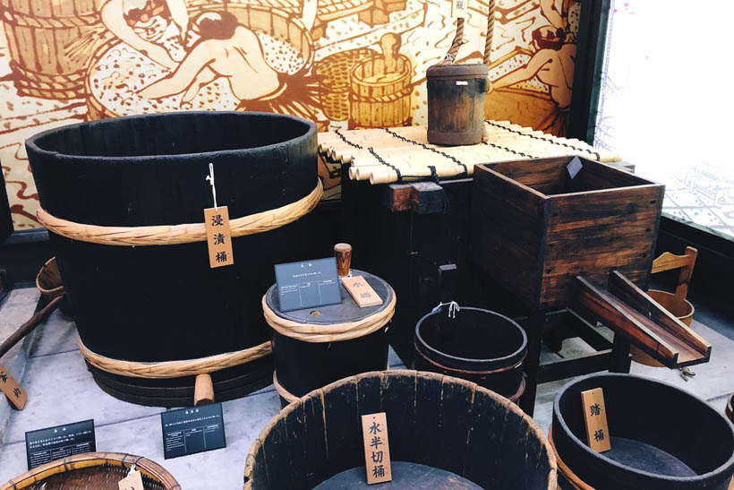 Traditional sake-making tools at the Gekkeikan Okura Sake Museum in Kyoto, Japan.