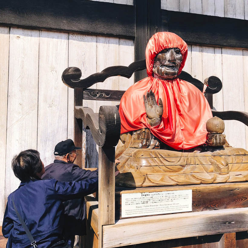 A dressed up statue of Binzuru (Pindola Bharadvaja), one of the disciples of Buddha, just outside of the hall.