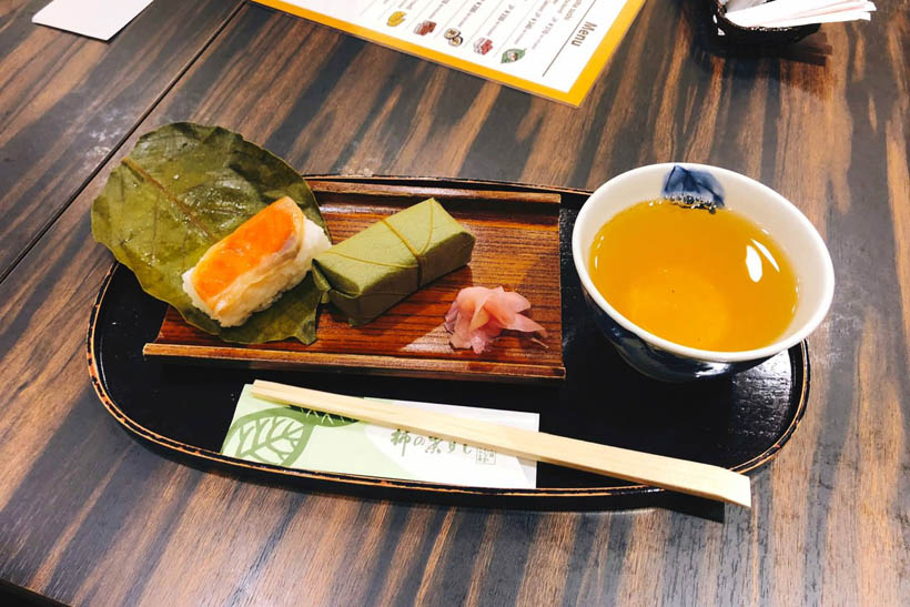 Persimmon leaf sushi with some green tea.