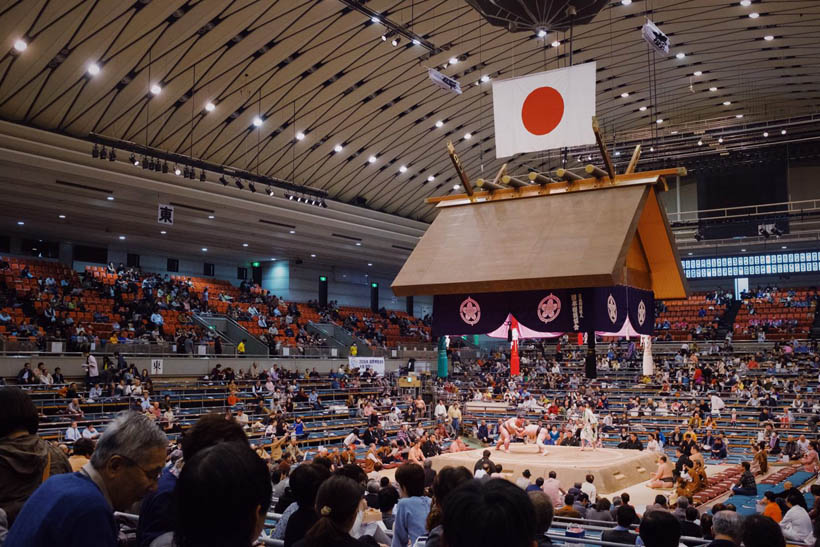 Sumo wrestlers in action at the Edion Arena in Osaka.