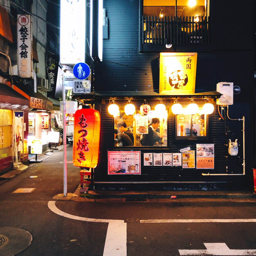 An Izakaya filled up with business men enjoying their evening off.