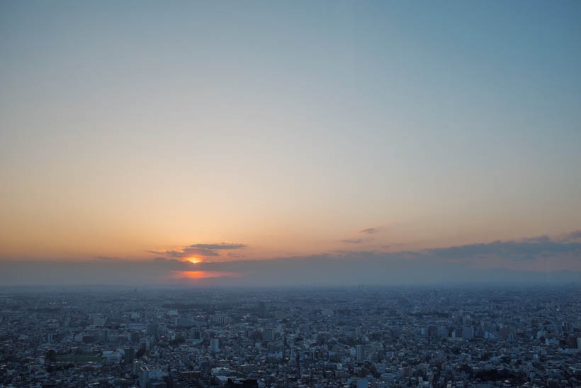 The skyline of Tokyo at sunset.