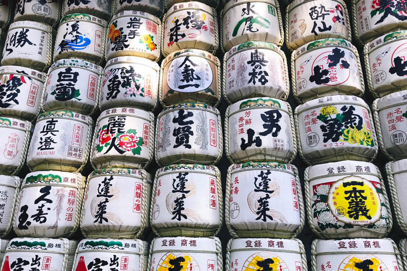 Sake barrels stacked as a wall.