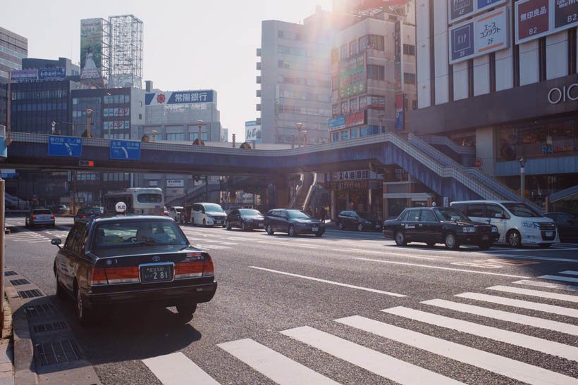 A taxi in front of the entrance of Ueno Station.