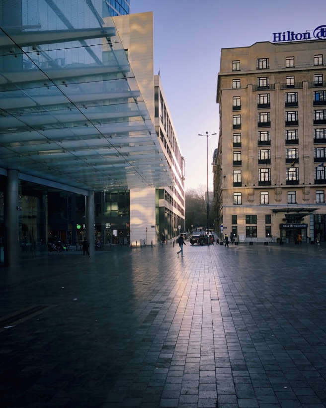 A picture of the sun rising at Place Rogier in Brussels.