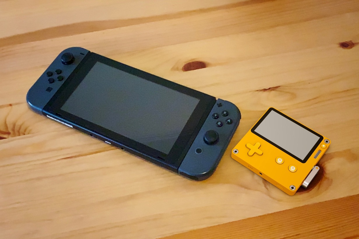 A 3D model of a Playdate in Augmented Reality, next to a Nintendo Switch for scale.