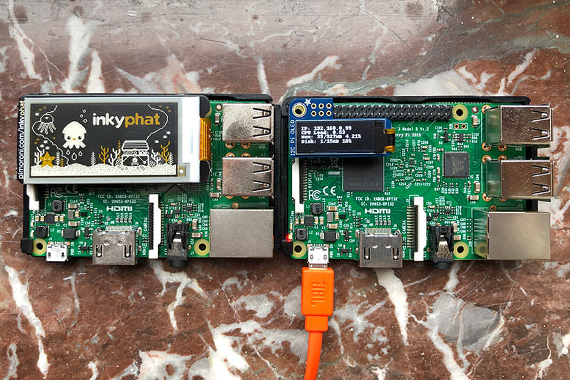 A set of Raspberry Pi computers with an eInk and OLED screen